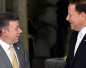 Juan Manuel Santos y Juan Carlos Varela. Foto: AFP