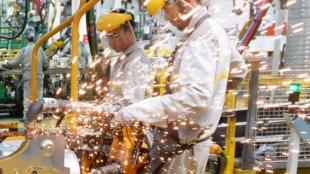 Trabajadores colombianos. Foto: AFP